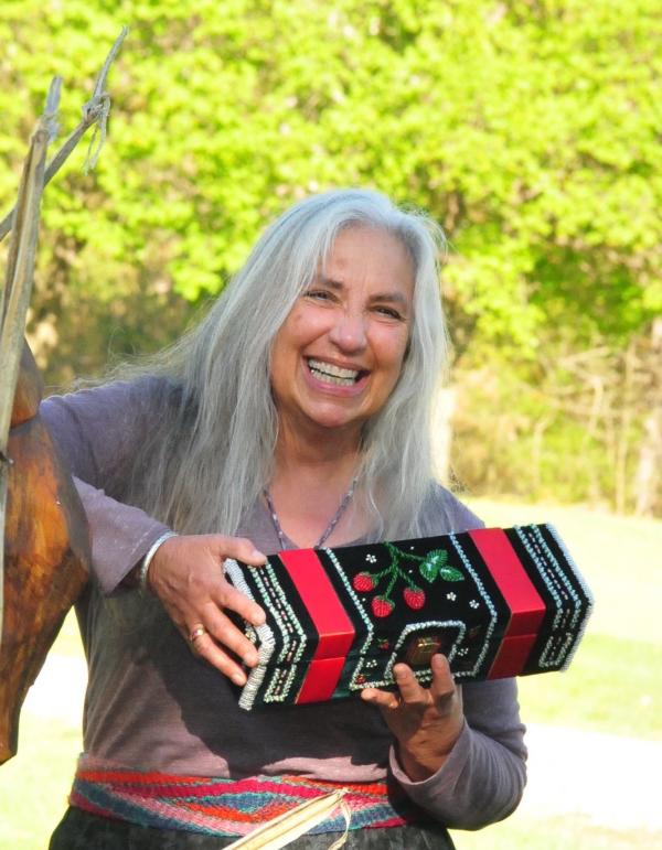Karen Ann Hoffman laughing and holding beaded box