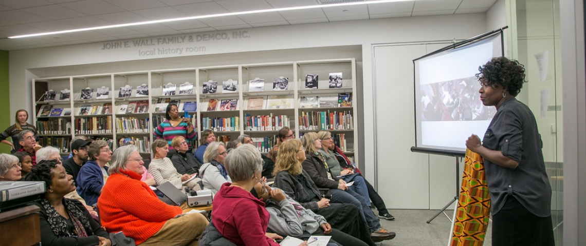 A writer addresses the audience at DeForest Public Library