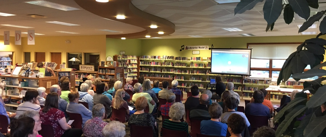 Mount Horeb Library Event with attendees looking at Skype projected on screen